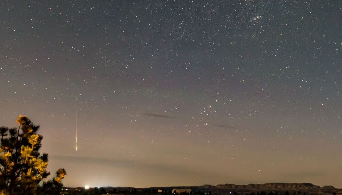 Jullie Powell captured this bright meteor heading down toward the horizon. Credit: Jullie Powell Photography
